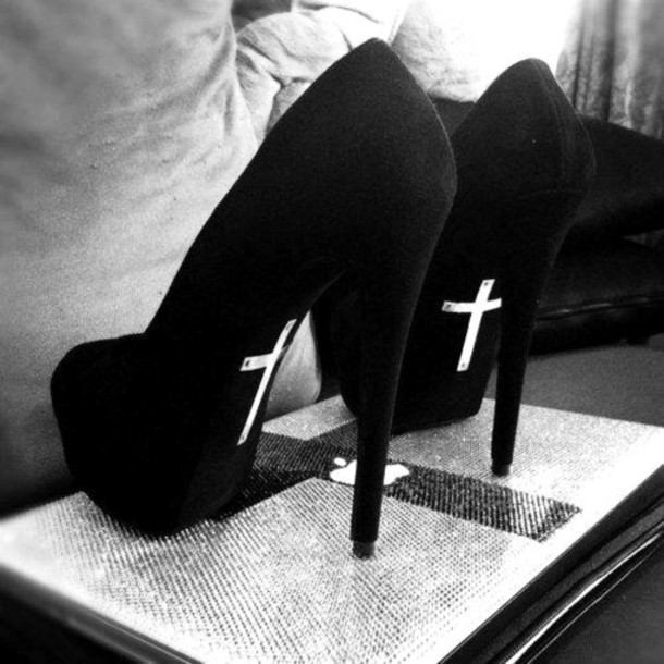 iIgh heels with a cross on the back